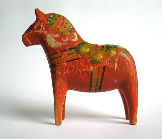 The wooden horses are painted in the kurbits style. This one from around 1950.