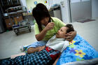 Disabled Child being fed by a home nurse
