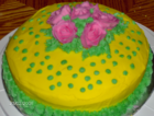 yellow cake and pink roses.png