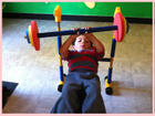 A kid is learning workout activity from the very young age