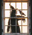 Halloween - witch with raven contrejour thru window