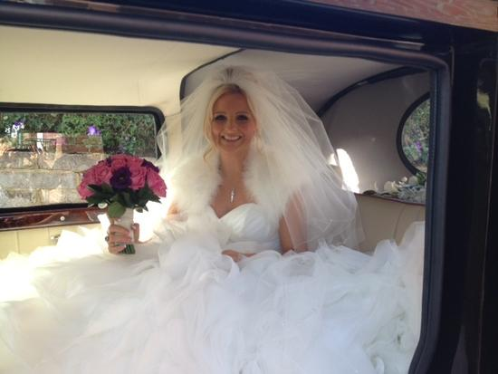 Gemma in wedding car.JPG