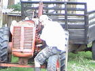 Jacinto at work on our 60 year old tractor
