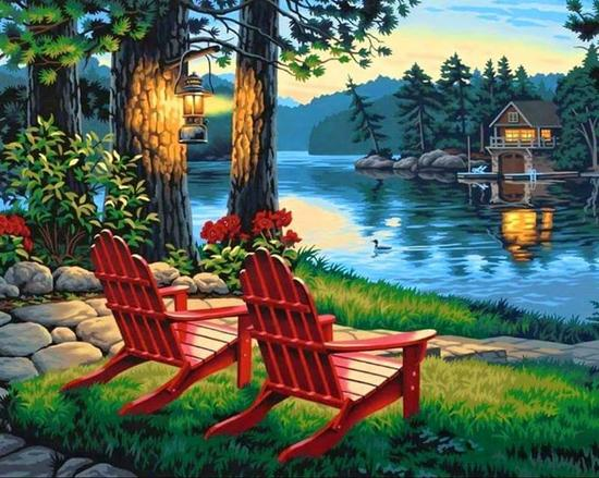two chairs on lake