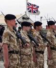 British soldiers stand in formation in the southern Iraqi city of Samawa March 7