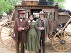 3 in front of the stagecoach