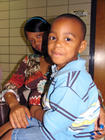 Pregnant mother and son at New Orleans health care clinic.jpg