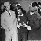 040107saddam-harvey-oswald.jpg
