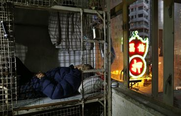 Hong Kongu0027s Poor Living In Cages, Cubicles Amid Staggering Wealth