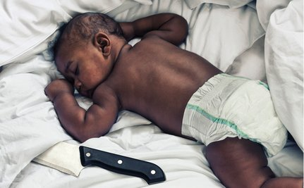 Infant Mortality Campaign Depicts Knife In Bed With Baby