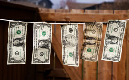 Money May Be Dirtier Than Toilet Seats