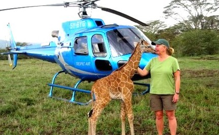 Photos Reveal Joyful Life of Baby Giraffe Rescued By Helicopter