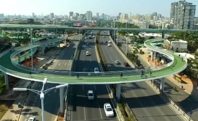 China Announces Worlds Longest Cycling Skyway Care Causes - China opens worlds longest skywalk