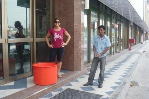 Miriam from the Dubai Aquarium and pet shop employee wait outside the door for the shop owner.