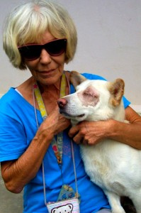 Marianne with Hero, a blind dog who can no longer live in a temple environment.