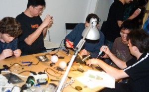 People collaborating at a hackerspace.