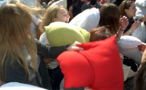 People having a massive pillow fight.
