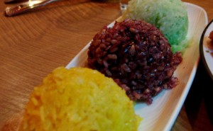 Three types of sticky rice, laid out on a dessert dish.