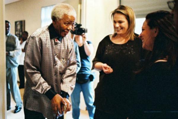 Mandela speaking with Gelman and Zelda LaGrange