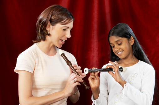 music teacher and student, music in our schools