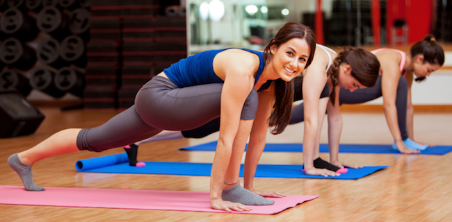 Runner's lunge in a yoga class.