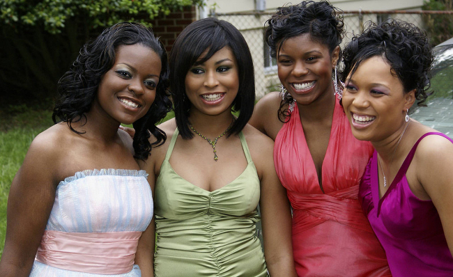 A group of Black girls dressed for prom.