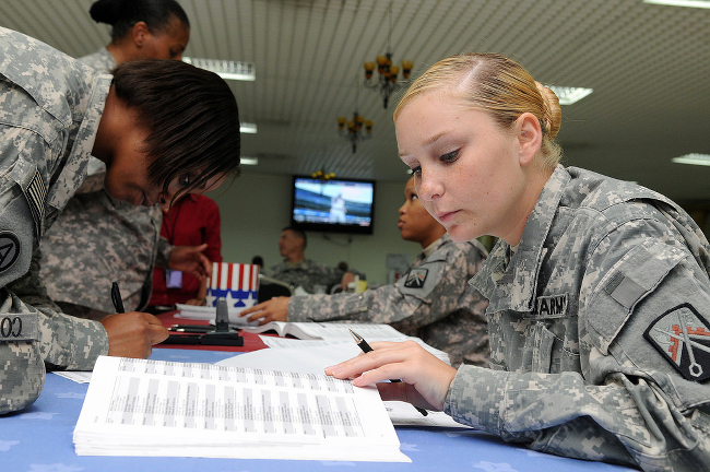 Soldiers making calls during a voter information drive.
