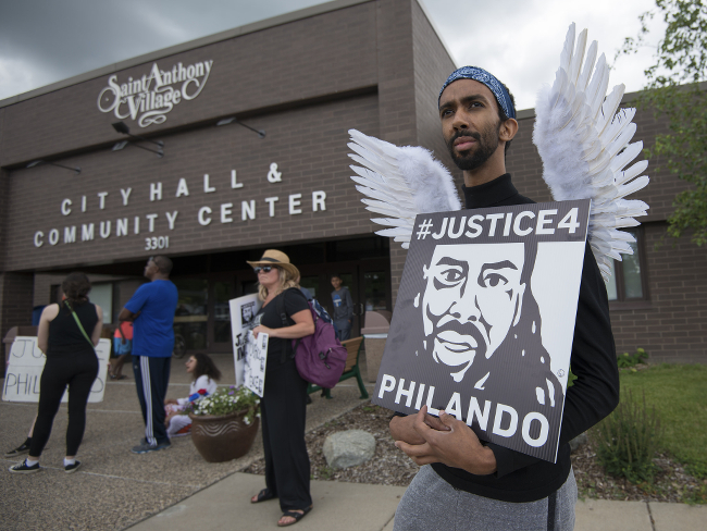 Protesters gathered in front of a community center to speak their minds on the verdict in the Philando Castile shooting.