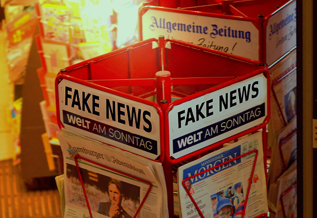 A newstand modified to read FAKE NEWS.