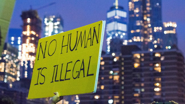 A no human is illegal protest sign