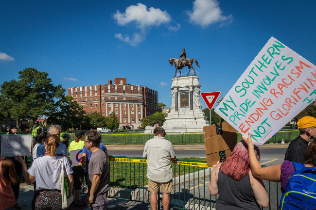 Protesters rallying around a confederate statute