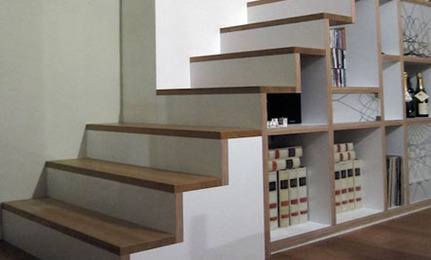 Folio offers bespoke storage designs particularly for school libraries,  including this CD+DVD storage unit incorporated onto the side of a staircase .