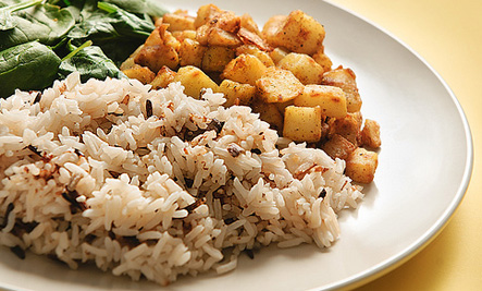 Vegan wild rice with mushrooms, spiced potatoes, and spinach