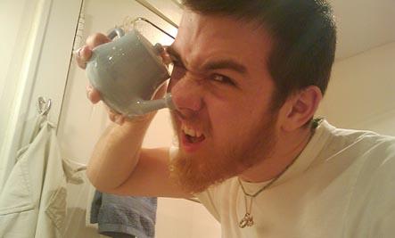 man using a neti pot
