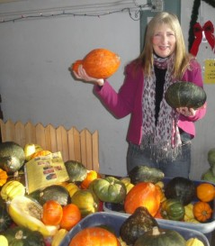 Diana Herrington at farmer's market with squash