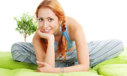 Smiling woman on bed