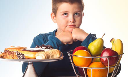 Child having to pick between healthy and unhealthy foods