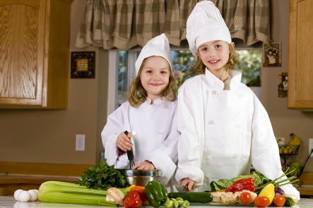 child cooks at real food for life