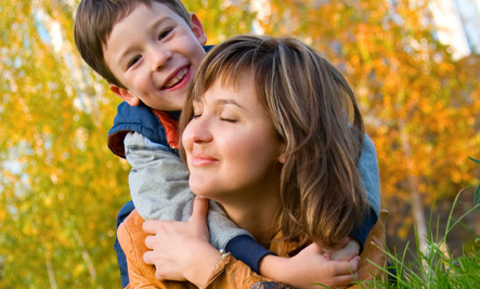 Mother with happy child outdoors