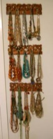 If you have a lot of jewelry, display it on a wall and make it an interesting art piece