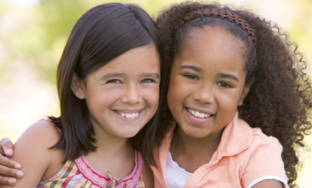 Multicultural 2 Girls Hugging