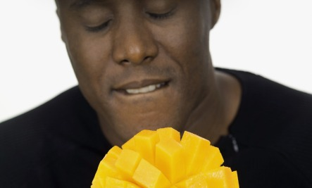 man holding mango  at Real Food for Life.com