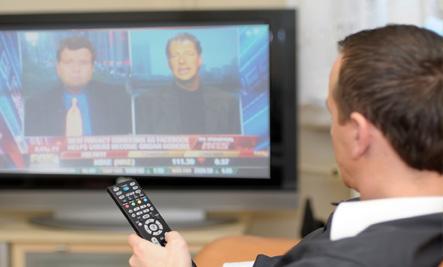 man watching news
