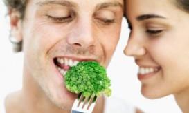 couple eating broccoli