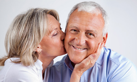 Older Happy Couple - woman kiss man