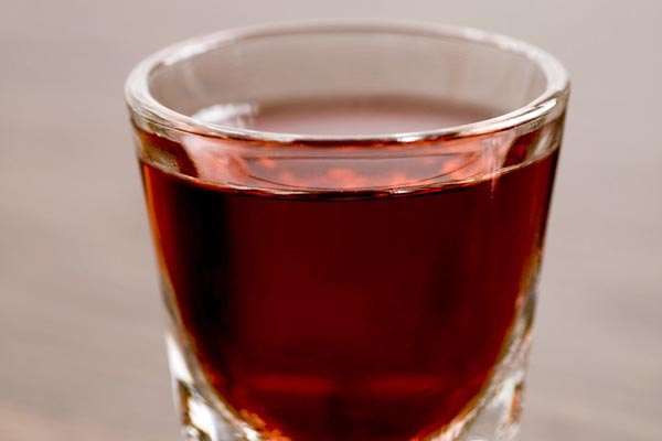 shot of unsweetened cranberry juice
