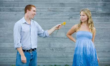 sorry-couple-annoyed-girl - man give woman flower rose
