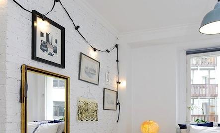 globe-lights-indoors-brick-wall