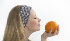 woman enjoying orange