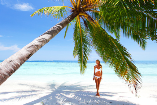Palm tree beach woman care2 healthy living palm tree beach woman voltagebd Image collections
